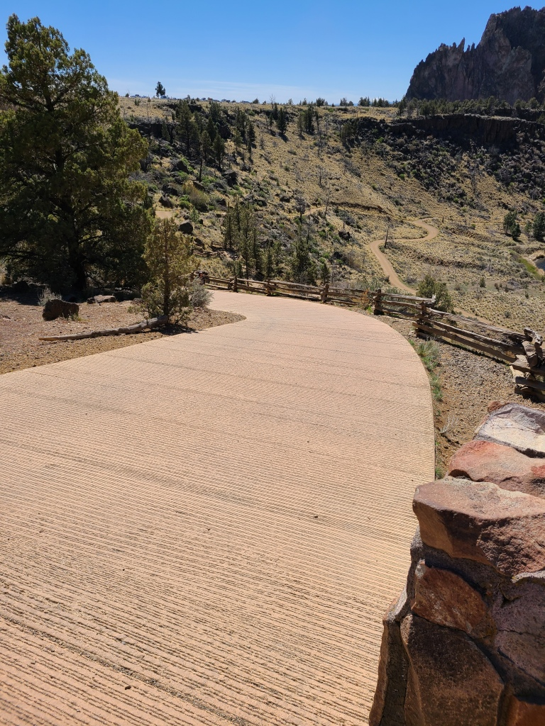 Paved trail leading down to the canyon.