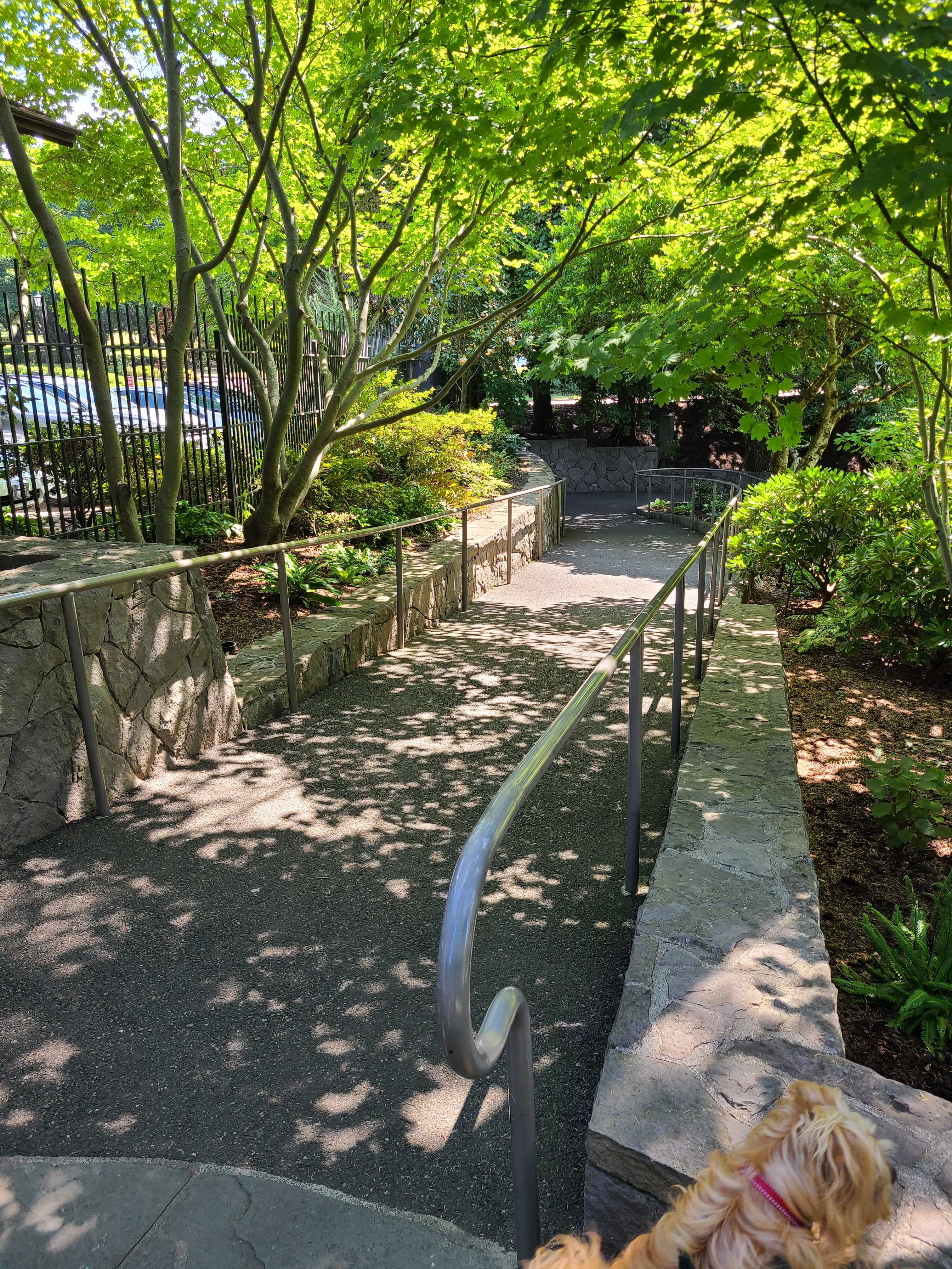 A portion of the ADA accessible ramp with handrails.